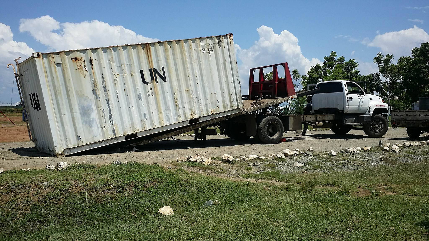united nations (u.n.) containers leaving on truck